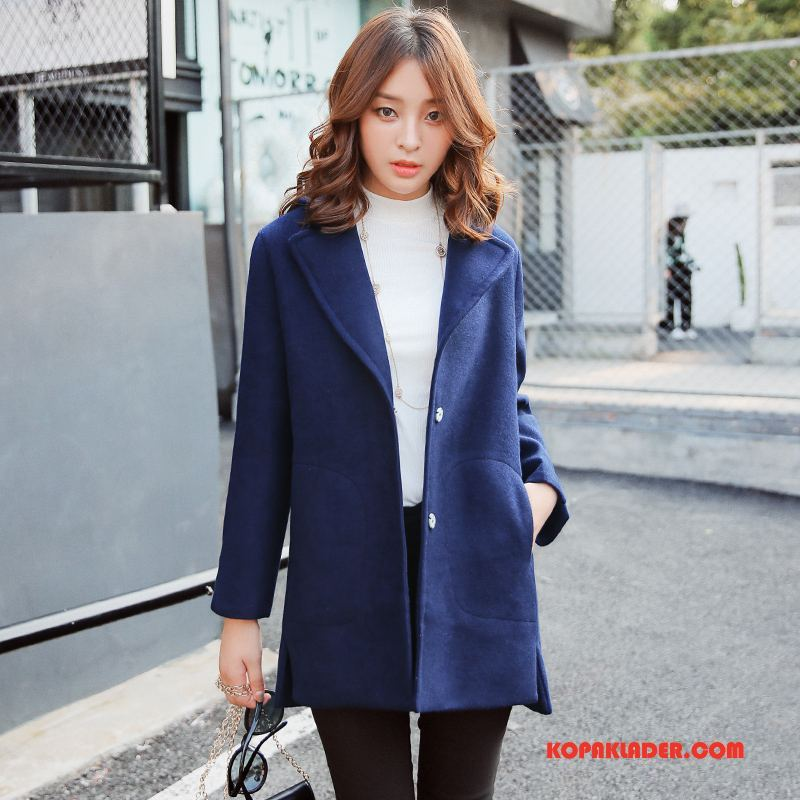 marinblå kostym dam